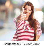 Small photo of portrait of a beautiful young woman doing an affirmative gesture