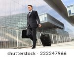 Businessman Walking With...