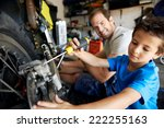 a boy helping his dad with... | Shutterstock . vector #222255163
