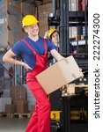 man with a backache in a factory   Shutterstock . vector #222274300