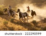 Two Western Cowboys Riding...
