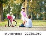 girl in park  helps boy with...   Shutterstock . vector #222301060
