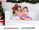 two girls reading a book in the ... | Shutterstock . vector #222305380