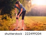 young woman limbering up before ... | Shutterstock . vector #222499204