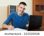 man  with laptop and financial ... | Shutterstock . vector #222520528