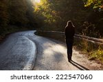 Woman Walking On Road In Autum...