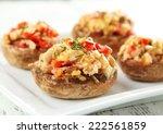stuffed mushrooms on plate   Shutterstock . vector #222561859