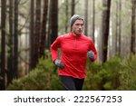 running man in forest woods... | Shutterstock . vector #222567253