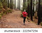 man running in forest woods... | Shutterstock . vector #222567256