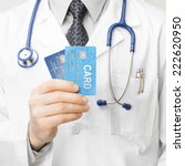 doctor holding credit cards   1 ...   Shutterstock . vector #222620950