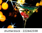 red dice in the cocktail glass... | Shutterstock . vector #222662338