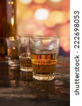 bottle and three glasses of rum ... | Shutterstock . vector #222698053