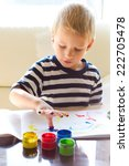 the boy is painting with... | Shutterstock . vector #222705478