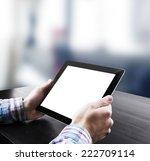 hand holding tablet in office   Shutterstock . vector #222709114