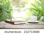 notebook  and coffee on wooden... | Shutterstock . vector #222713080