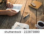 man reading a book and writing... | Shutterstock . vector #222873880