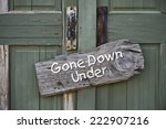 Gone down under sign on old door.