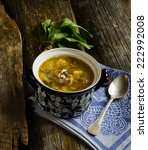 Small photo of green soup with sorrel (green sorrel shchi)