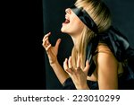 blindfold women cry and a lot... | Shutterstock . vector #223010299