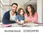 child having breakfast with her ... | Shutterstock . vector #223024930