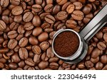 Filter holder for espresso coffee machine and coffee beans - stock photo