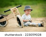 Little Boy With Wooden Tricycl...