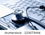 stethoscope on desk | Shutterstock . vector #223073446