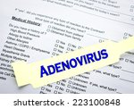 Small photo of A adenovirus patient bracelet on top of a hospital questionnaire paperwork