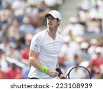 Small photo of NEW YORK, NY - SEPTEMBER 1, 2014: Andy Murray of United Kingdom reacts during 4th round match against Jo-Wilfried Tsonga at US Open in Flushing Meadows USTA Tennis Center