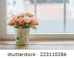 Artificial Roses In The Basket