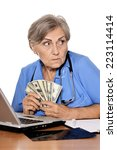 senior doctor sitting at table... | Shutterstock . vector #223114414