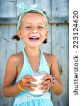 cute little girl with a glass... | Shutterstock . vector #223124620