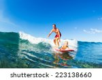 father and son surfing together ... | Shutterstock . vector #223138660
