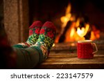 feet in woollen socks by the... | Shutterstock . vector #223147579