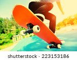 skateboarding woman legs at... | Shutterstock . vector #223153186