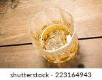 yellow golden alcoholic drink... | Shutterstock . vector #223164943