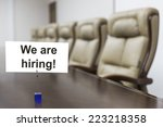 "closeup of ""we are hiring"" sign ... 