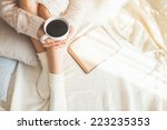 soft photo of woman on the bed... | Shutterstock . vector #223235353