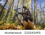bow hunter crouching | Shutterstock . vector #223242493