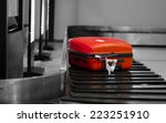 red bagged on the conveyer in... | Shutterstock . vector #223251910