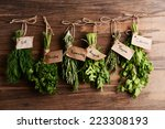 Different Fresh Herbs On Woode...
