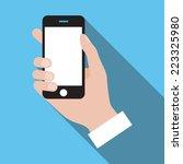 vector phone in hand flat icon | Shutterstock .eps vector #223325980