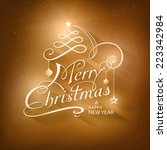 christmas card in golden brown... | Shutterstock .eps vector #223342984