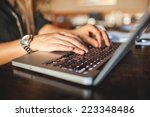 hands of young business woman... | Shutterstock . vector #223348486