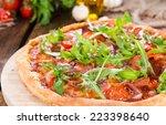 ham pizza with rocket  fresh... | Shutterstock . vector #223398640