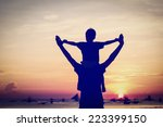 happy father and son on sunset... | Shutterstock . vector #223399150