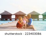 father with kids on tropical... | Shutterstock . vector #223403086