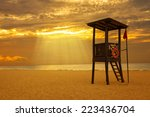 sunrise in a caribbean beach | Shutterstock . vector #223436704