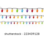 color christmas light bulbs on... | Shutterstock .eps vector #223439128