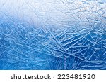 ice flowers and frozen window...   Shutterstock . vector #223481920